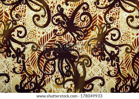 Fabric with floral batik pattern - stock photo