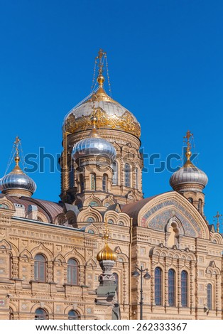 Facade and golden domes of Assumption Church on Vasilevsky Island. Orthodox church in Saint-Petersburg, Russia - stock photo