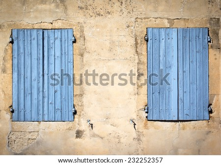 Facade and window with closed shutters of an old house in a little village (South of France). - stock photo