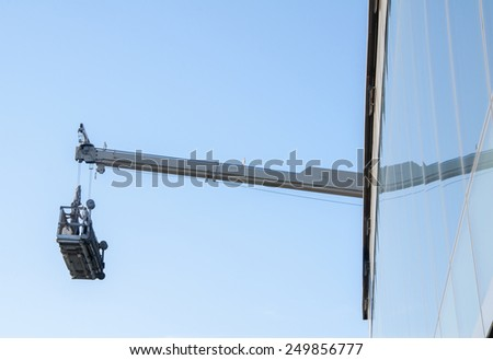 Facade cleaning elevator for big buildings - stock photo
