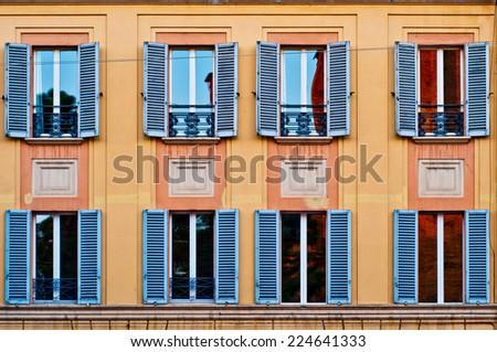 Facade of a building with windows in Bologna Italy - stock photo