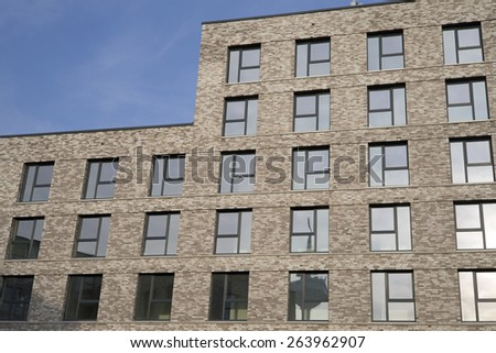 Facade of a modern apartment building - stock photo