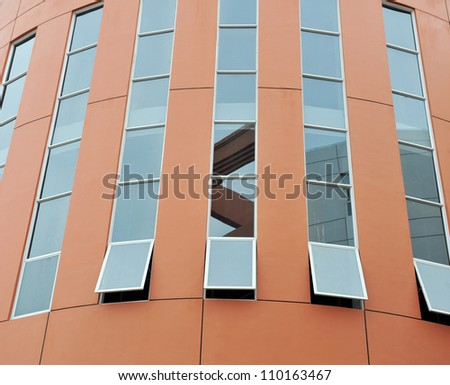 Facade of a modern office building with glass windows - stock photo