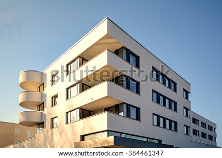 Facade of  a new residential building, new low-energy-standard development - stock photo