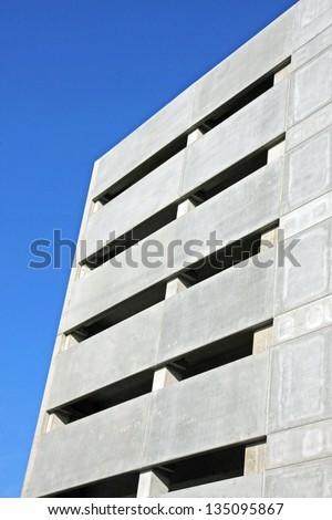 facade of a skyscraper and multi storey indoor parking - stock photo