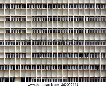 Facade of a symmetrical building block for the concept of congested urbanscape.  - stock photo