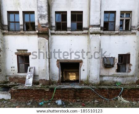 facade of an abandoned factory - stock photo
