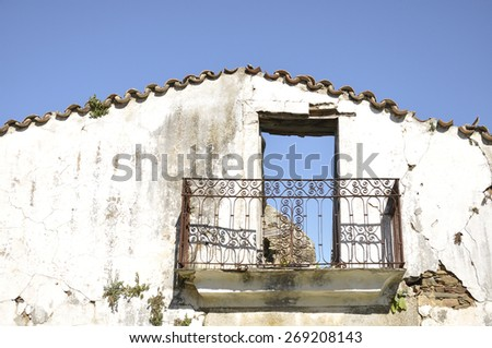 Facade of an old abandoned house in a uninhabited Spanish village  - stock photo