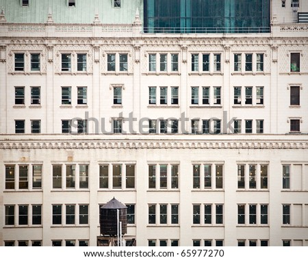 facade of an old building in a big city, vintage - stock photo
