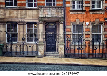 Facade of an old building made in Victorian red brick and terracotta architectural style in the center of Birmingham, UK - stock photo