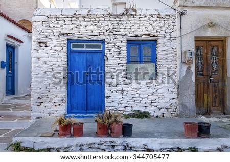 Facade of an old house in Kythnos island, Cyclades, Greece - stock photo
