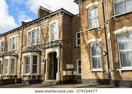Facade of British Victorian family houses - stock photo