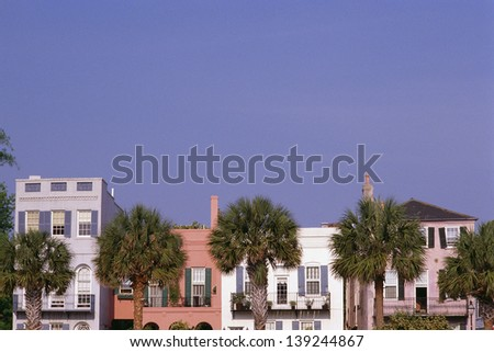 Facade of colorful historic houses in Charleston, SC - stock photo