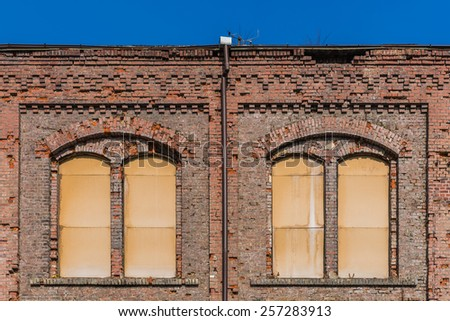 Facade of devastated building in an old mine in Katowice, Poland. - stock photo
