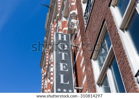 Facade of hotel in Amsterdam, The Netherlands - stock photo