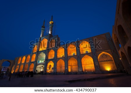 Facade of illuminated Amir Chakhmaq mosque situated in a square with similar name, against dark blue sky in the city of Yazd. - stock photo