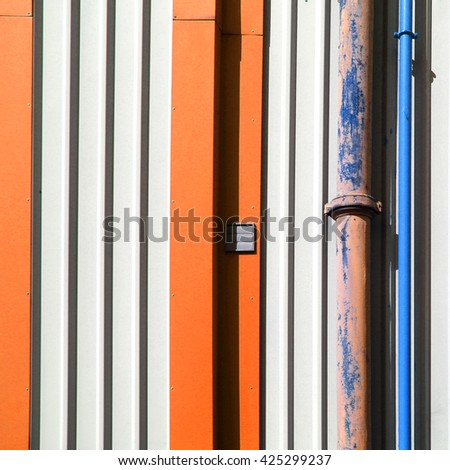 Facade of industrial warehouse with gutter pipes - stock photo
