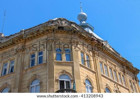 Facade of old house in historic city center. Lviv, Ukraine - stock photo