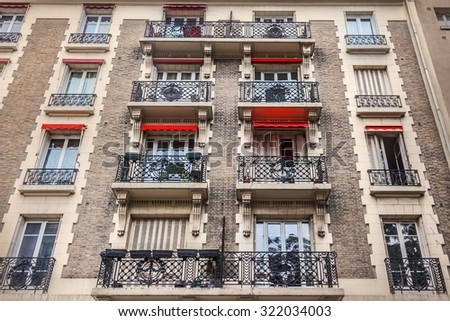 Facade of Parisian building - stock photo