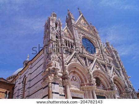 Facade of Siena Cathedral, Tuscany, Italy - stock photo