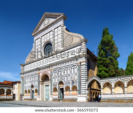 Facade of the Basilica of Santa Maria Novella in Florence, Tuscany, Italy. The church on blue sky background at summer. Florence is a popular tourist destination of Europe. - stock photo