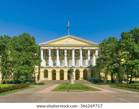 Facade of the Smolny Institute (the official residence of the governor of St.Peterburg now) with a Lenin statue in the foreground. Russia - stock photo