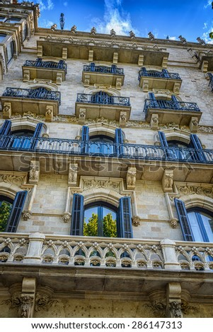 Facade of typical residential building in  Eixample district, Barcelona, Spain - stock photo