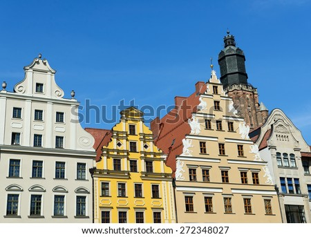 Facades of colour buildings on the old square in Wroc�³aw, Poland - stock photo