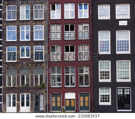 Facades of houses in old city in Amsterdam - stock photo