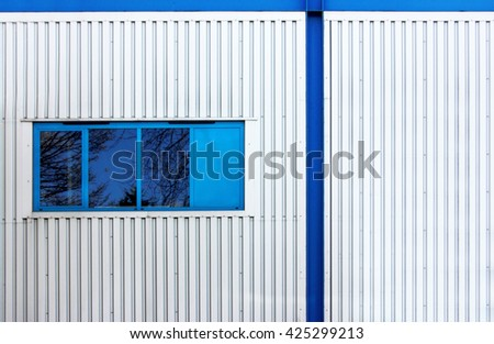 Facades of Industrial buildings, constructions in business and manufacturing  - stock photo