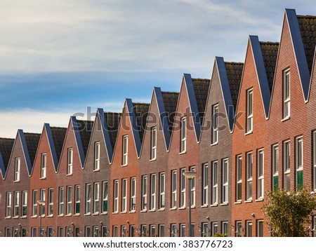 Facades of Modern Real Estate Family houses in a row - stock photo