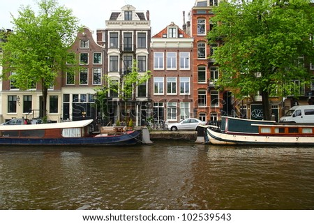 Facades over a canal in Amsterdam - stock photo