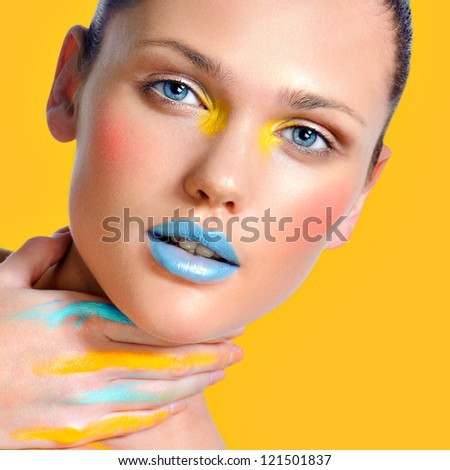 Face art Makeup cosmetics, Closeup portrait in color bandage  of beautiful woman model face with clean skin on white background. Natural skincare beauty, clean soft skin - stock photo