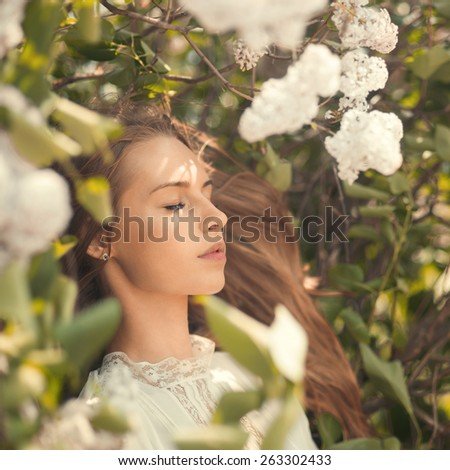 face beautiful sexual girl in the park among flowers - stock photo