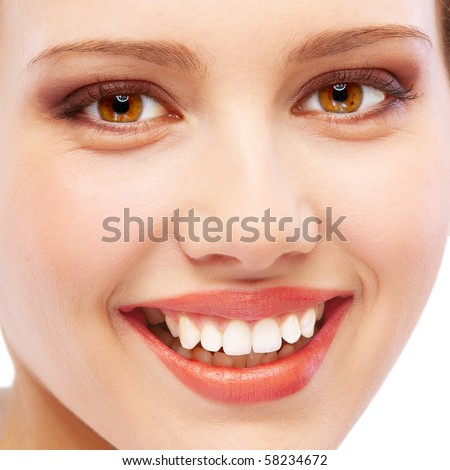 Face close up of smiling young woman, isolated on white background. - stock photo
