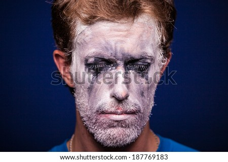 Face crying mime on a blue background. - stock photo