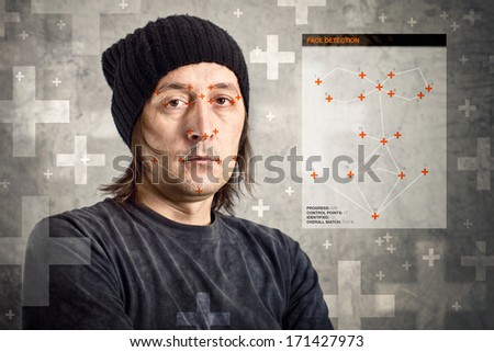 Face detection software recognizing a face of man with black cap - stock photo