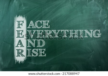 face everything and rise - FEAR acronym on green chalkboard - stock photo