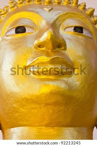 Face golden Buddha. Face golden Buddha as contemporary art. - stock photo