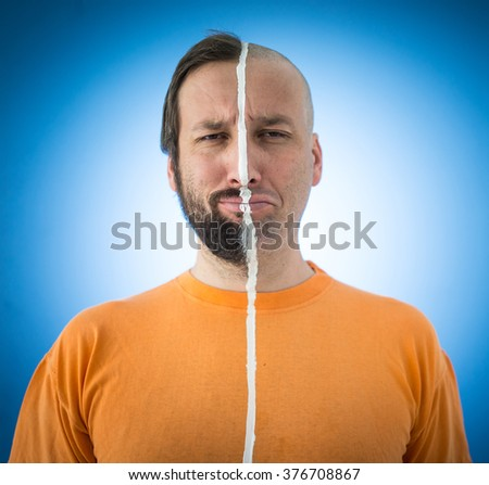 Face in two sides parts of man - stock photo
