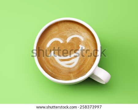 Face Laughing Coffee Cup Concept isolated on green background - stock photo