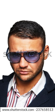 Face of a bearded man wearing sunglasses - stock photo