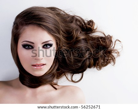 Face of a beautiful woman with beauty black eyes and long  brown hairs - stock photo