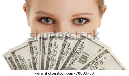 face of a beautiful young woman and the money- dollars - stock photo