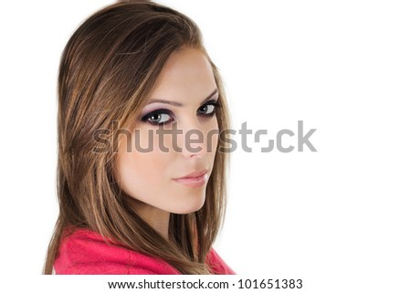 Face of a beautiful young woman with brown long hairs - stock photo