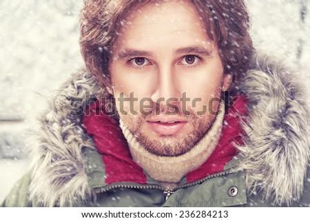 Face of a man with beard bristles, winter - stock photo