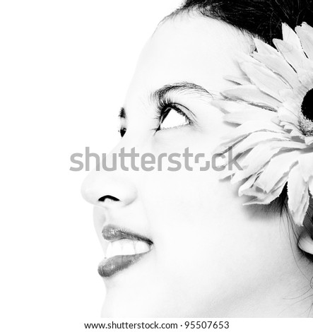 Face Of An Attractive Young Girl In Black And White - stock photo
