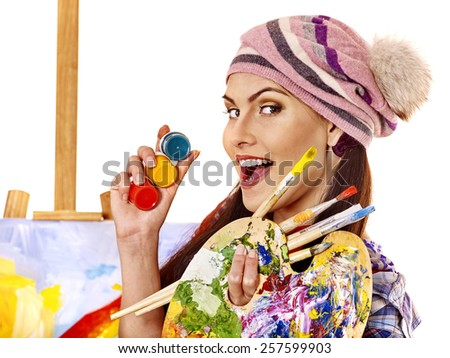 Face of artist woman with paint palette. Paiting in hand. - stock photo