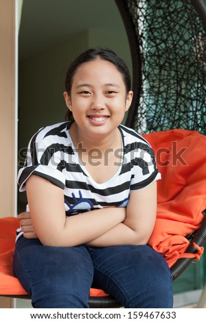 face of asian girl toothy smiling with relaxing emotion  - stock photo