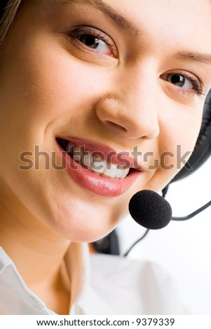 Face of attractive Customer Support Representative  with a smile - stock photo